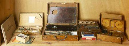One shelf of early 20th century art supplies