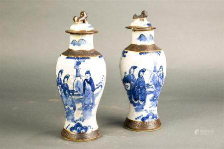 Pair of Chinese blue and white crackle glazed covered vases