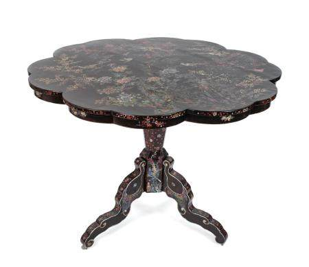 A Japanese Nagasaki ExportLacquer Center Table Height 32 1/4 x diameter 42 1/4 inches.