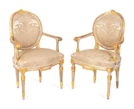 A Pair of Italian Neoclassical Painted and Parcel Gilt Armchairs Height 39 inches.