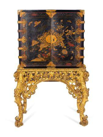 A Chinese Brass-Mounted Gilt-Decorated Black Lacquer Cabinet on Later Giltwood Stand Height 59 x width 32 1/2 x depth 17 inches.