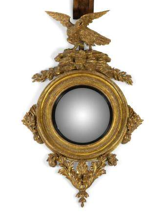 An Irish Giltwood Convex Mirror Height approx. 60 x width 36 inches.