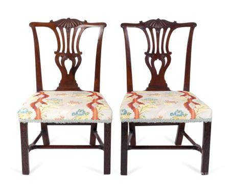 A Pair of George II Carved Mahogany Side Chairs Height 36 1/2 x width 22 1/2 inches.
