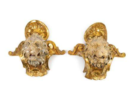 A Pair of English Part Silvered Giltwood Lion Masks Height 20 x width 26 inches.