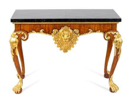 A Pair of George II Style Parcel-Gilt Walnut Consoles Height 30 1/2 x width 43 x depth 19 inches.