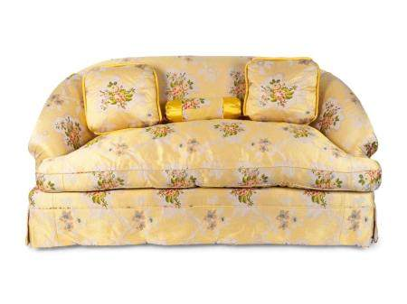 An Upholstered Loveseat with Three Cushions Height 33 x width 68 inches.