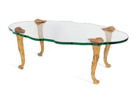 A French Carved Giltwood and Cartouche-form Glass Coffee Table