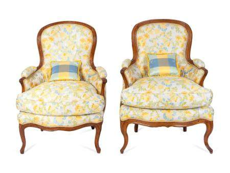 A Pair of Louis XV Style Carved Walnut Bergeres Height 36 1/2 x width 26 1/2 inches.