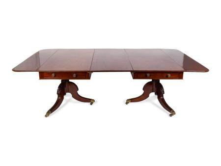 A Regency Style Mahogany Two-Pedestal Dining Table Height 29 x width 94 x depth 53 1/2 inches.