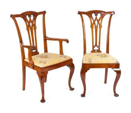 Eleven George II Style Mahogany Dining Chairs Height 42 1/2 inches.