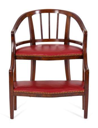 A Georgian Style Mahogany and Red Leatherette Library Chair Height 30 x width 23 3/4 x depth 21 inches.