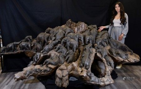 Amazing Unique Art Wood Carving of 47 Elephants Carved from One Piece of Wood