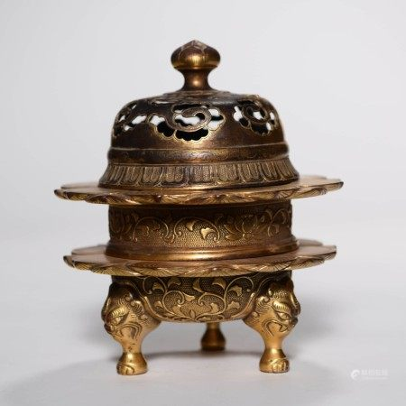 A Trilaminar Gild Bronze Three-legged Incense Burner