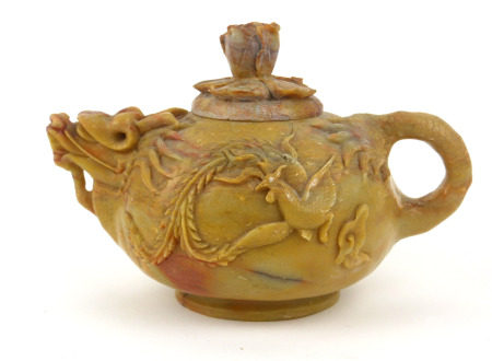 AN EARLY QING DYNASTY CHINESE SOAPSTONE DRAGON TEAPOT AND COVER The ovoid body with delicate spout