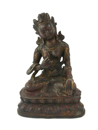 A TIBETAN BRONZE LAKSHMI BUDDHA FIGURE Seated pose with scrolled headdress and elaborate necklace,