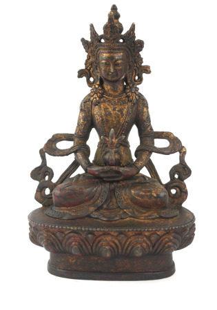 A TIBETAN GILT BRONZE LAKSHMI BUDDHA FIGURE Seated pose with elaborate headdress, on a lotus