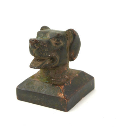 A CHINESE BRONZE CANINE DESK SEAL Having the bust of a dogs head with archaic form seal to base. (