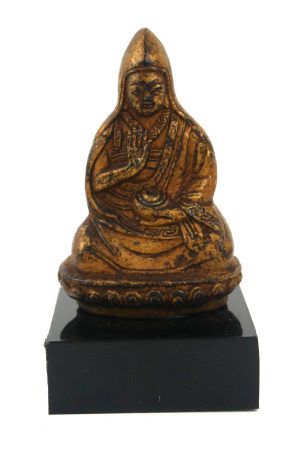 A CHINESE GILT BRONZE BUDDHA Seated pose holding an urn on black perspex base. (Buddha approx 6.7cm)