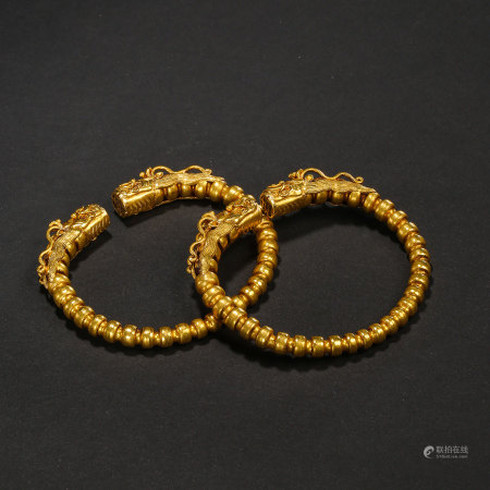 MING DYNASTY, A PAIR OF CHINESE PURE GOLD DOUBLE DRAGON BRACELETS