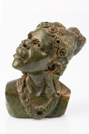 CARVED PORTRAITS BY E· MUTEDZI, A FAMOUS SCULPTOR