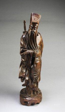 A Carved Hardwood Figurine
