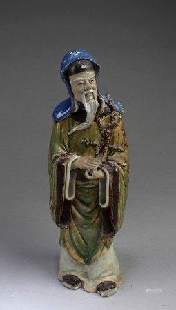 A Porcelain Deity Statue