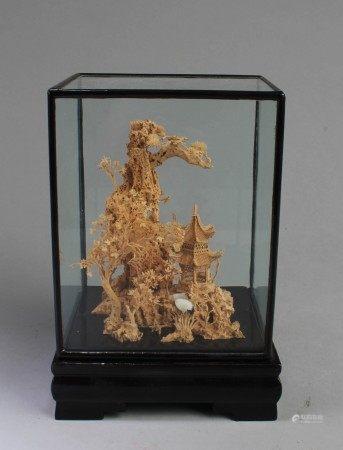 A Framed Cork Carving Ornament