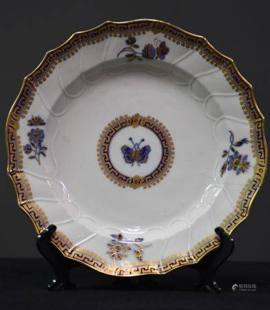 Rare assiette en porcelaine de Tournai à décor bleu et or d'un papillon ( éclat et fêle ). XVII