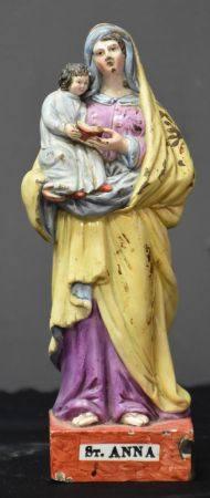 Faïence fine XVIII ème polychrome représentant Sainte Anne. Ht 19,5 cm.