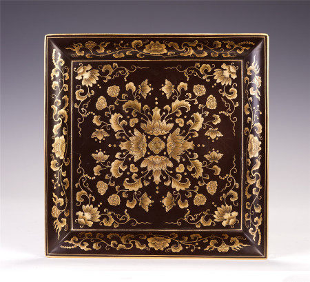 A CHINESE CARVED LACQUER SQUARE PLATE