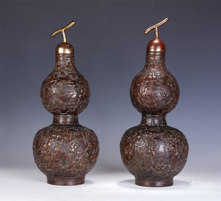 A PAIR OF CHINESE CARVED HARDWOOD DOUBLE-GOURD VASES