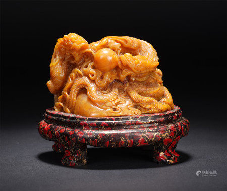 A CHINESE SOAPSTONE CARVING OF DRAGONS
