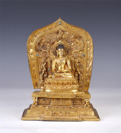 A CHINESE GILT BRONZE FIGURE OF SITTING BUDDHA
