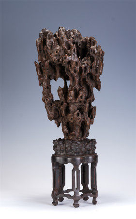 A CHINESE CARVED FREE-FORM HARDWOOD DECORATION