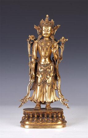 A CHINESE GILT BRONZE FIGURE OF STANDING BUDDHA