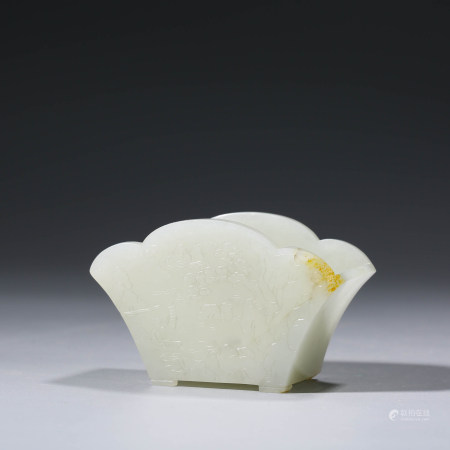AN CHINESE WHITE JADE WASHER