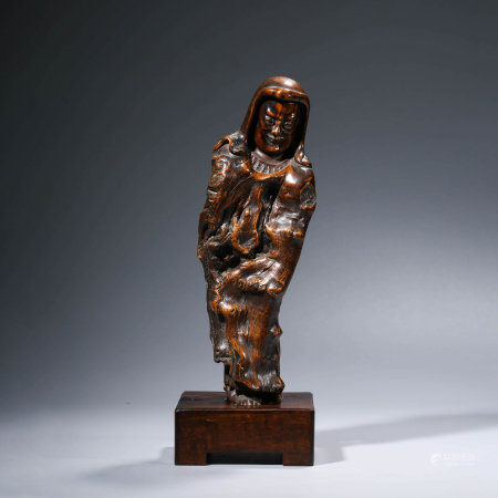 A CHINESE REDWOOD FIGURE CARVING