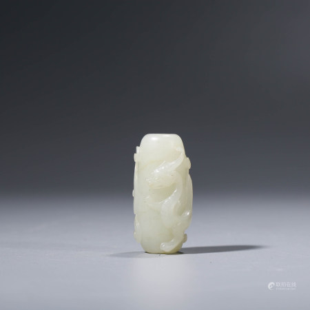 A CHINESE WHITE JADE CHI DRAGON ORNAMENT