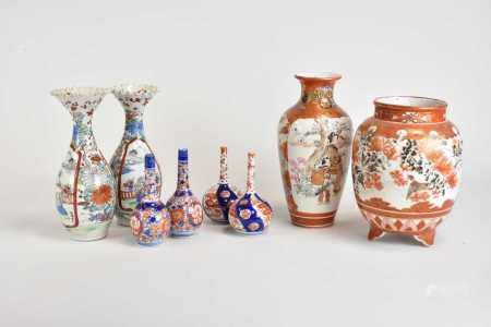 A group of Japanese Arita and Kutani porcelain, including two pairs of small Imari bottle vases,