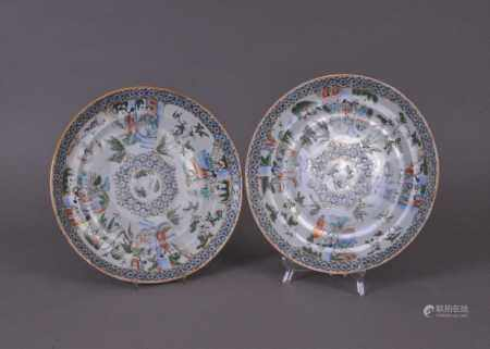 A pair of Chinese famille rose plates, Qing Dynasty, 19thcentury, decorated with panels of figures