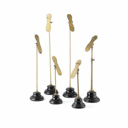 GROUP OF BRASS AND POTTERY SHOE DISPLAY STANDS LATE 19TH/ EARLY 20TH CENTURY