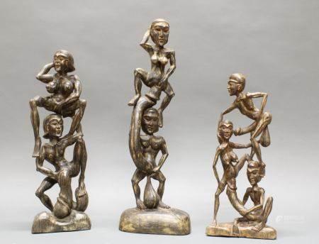 """3 Skulpturen, """"Erotische Figuren"""", Südostasien, 20. Jh., Holz, geschnitzt, 42.5-57 cm hoch"""