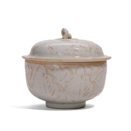A CARVED WHITE-GLAZED JAR AND COVER