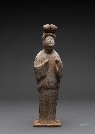 A CHINESE PAINTED POTTERY FIGURE OF A COURT LADY, TANG DYNASTY (618-907 AD)