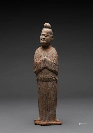 A CHINESE PAINTED POTTERY FIGURE OF A COURTIER, TANG DYNASTY (618-907 AD)