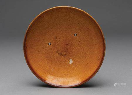 A CHINESE SHALLOW AMBER GLAZED BOWL, LIAO DYNASTY (907-1125 AD)