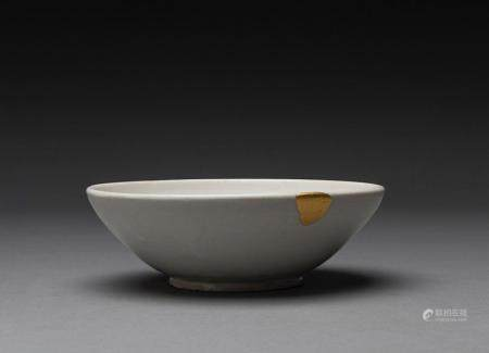 A CHINESE DING WHITE WARE BOWL, TANG DYNASTY (618-905)