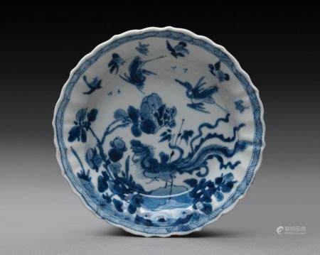 A CHINESE BLUE AND WHITE BARBED SAUCER DISH, KANGXI PERIOD (1662-1722)