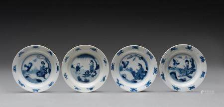 A SET OF FOUR CHINESE BLUE AND WHITE SAUCER-DISHES, KANGXI PERIOD (1662-1722)