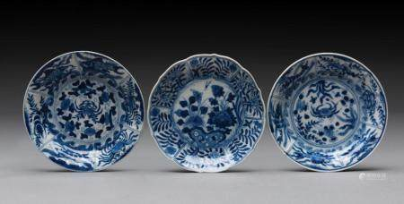 THREE CHINESE BLUE AND WHITE SAUCER-DISHES, KANGXI PERIOD (1662-1722)